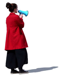 woman standing and talking into a megaphone