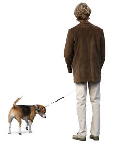 man in a brown jacket standing with his dog
