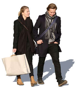 young man and a woman with a big shopping bag walking together