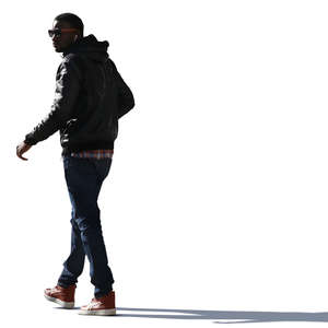 backlit black man walking on the street