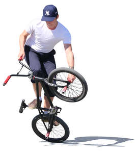 young man doing a bmx trick