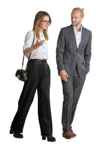 businessman and woman walking and talking