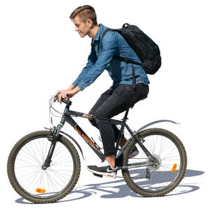 young man with a backpack riding a bike