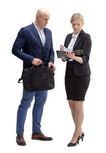 businessman and woman standing and looking at some papers