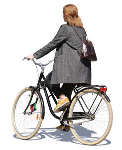 woman in a grey jacket riding a bicycle