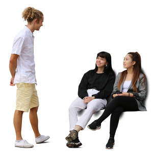 three young people sitting and talking