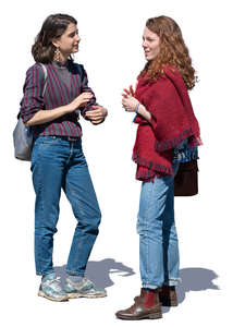 two women standing and talking