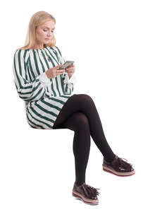 woman sitting and checking her phone