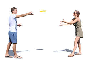 man and woman playing frisbee