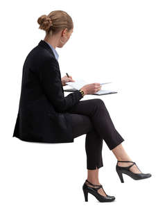 businesswoman sitting and checking her calendar