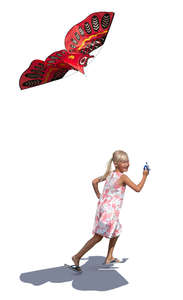 girl running and flying a kite
