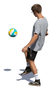 young man juggling a football ball