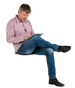 man sitting and working with tablet