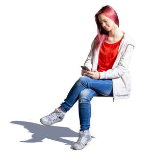 young woman with a phone sitting