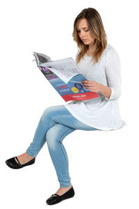 woman sitting and reading a newspaper