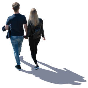 backlit couple walking seen from above