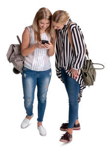 two women looking at a phone seen from above