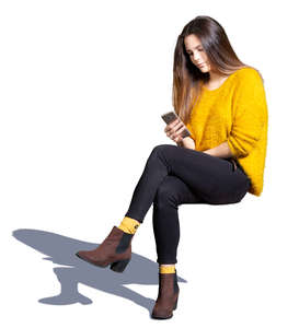 young woman sitting and texting