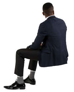 black man in a suit sitting