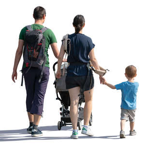 backlit family of three walking