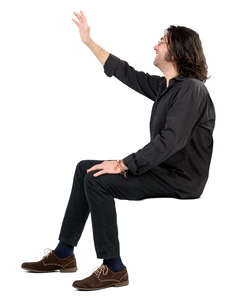 man sitting and waving