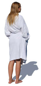 woman in a white bathrobe standing