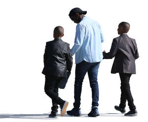 black man with two sons walking