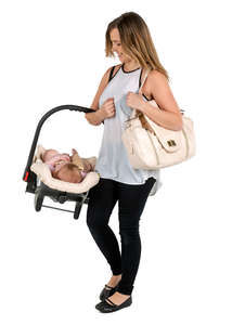 mother carrying her baby in a baby car seat