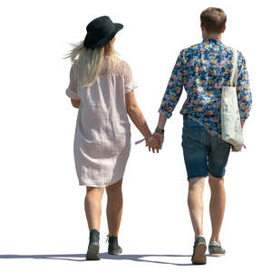 trendy couple walking hand in hand