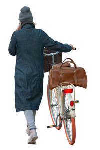 woman pushing a bicycle