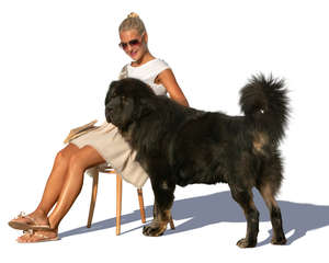 woman sitting and petting her dog