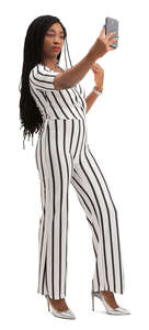 black woman in a striped jumpsuit taking a selfie