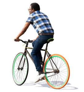 black man in a checkered shirt riding a bicycle