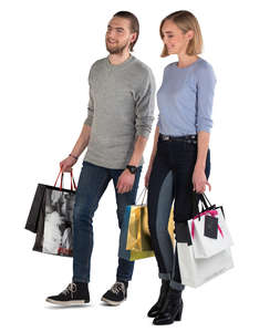 smiling man and woman with shopping bags walking