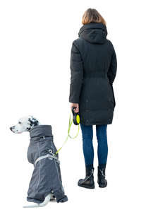woman with a dalmatian dog standing