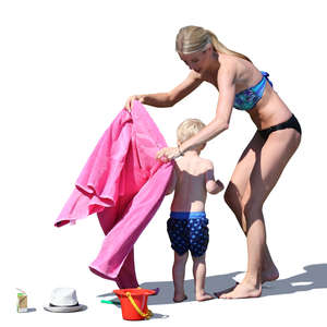 mother drying her son on the beach