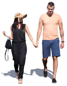 couple walking and holding hands in the summer