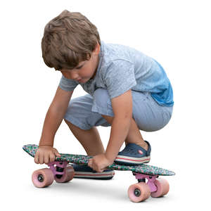 little boy playing with skateboard
