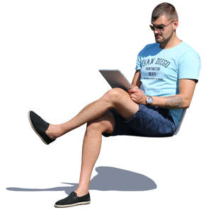 man sitting and reading smth on a tablet