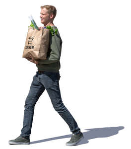 man with grocery bag walking