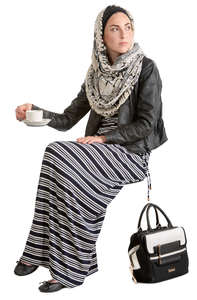 muslim woman sitting in a cafe