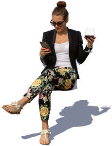 woman sitting and drinking wine