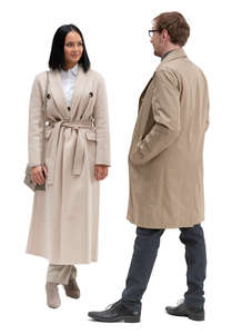man and woman in overcoats standing and talking
