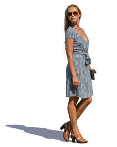 woman in a blue summer dress standing