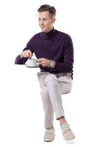 young man sitting and drinking coffee