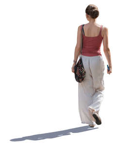 backlit woman walking on a sunny day