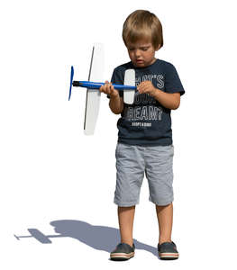 little boy playing with a toy plane