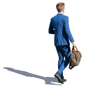 young man in a blue suit walking