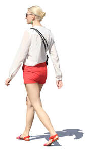 woman in red shorts walking