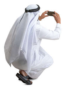 muslim man taking a picture